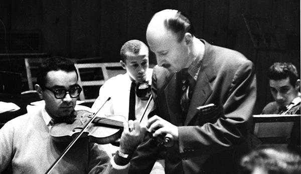 man teaching violinist