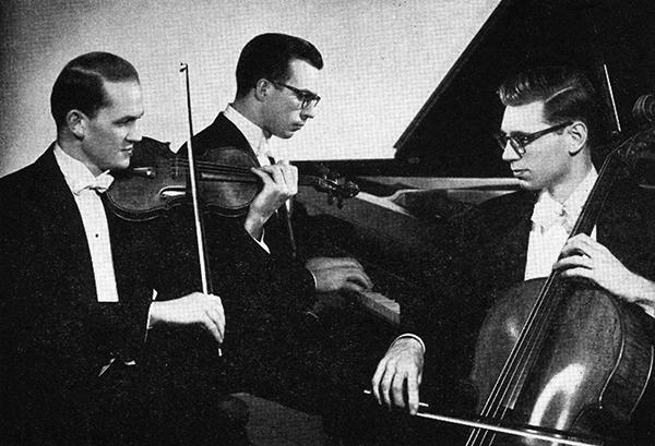 man playing violin, man at piano, man playing cello