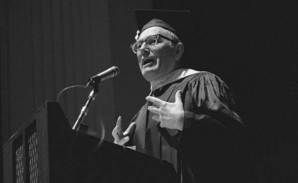 man speaking at graduation