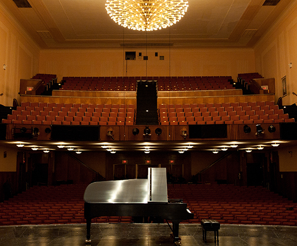 large concert hall with grand piano on stage